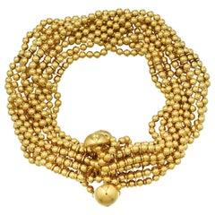 Cartier Draperie De Decollente Ten Strand Gold Bead Bracelet