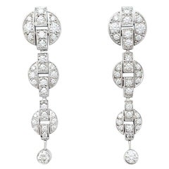 "Cartier Earrings, ""Himalia"" Collection Set with Diamonds"