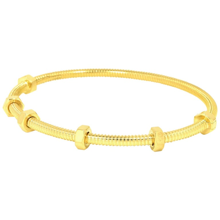 Cartier Ecrou in 18 Karat Yellow Gold For Sale