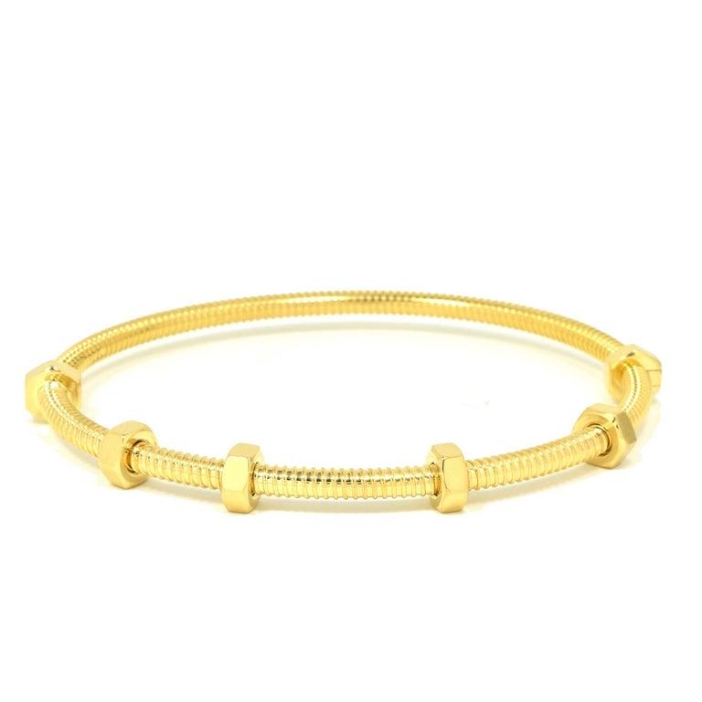 Bracelet Size:  19 = 19 cm  Designer: Cartier  Collection: Ecrou  Style: Bangle/Bracelet  Metal: Yellow  Gold  Metal Purity: 18k  Signature: Cartier  Hallmarks: Cartier; AU750   Includes:  24  Months Brilliance Jewels Warranty   Cartier Box