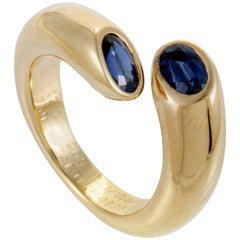 Cartier Ellipse Deux Tête Croisees 18 Karat Yellow Gold Sapphire Band Ring