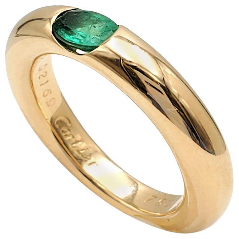 Cartier 'Ellipse' Gold and Emerald Ring For Sale