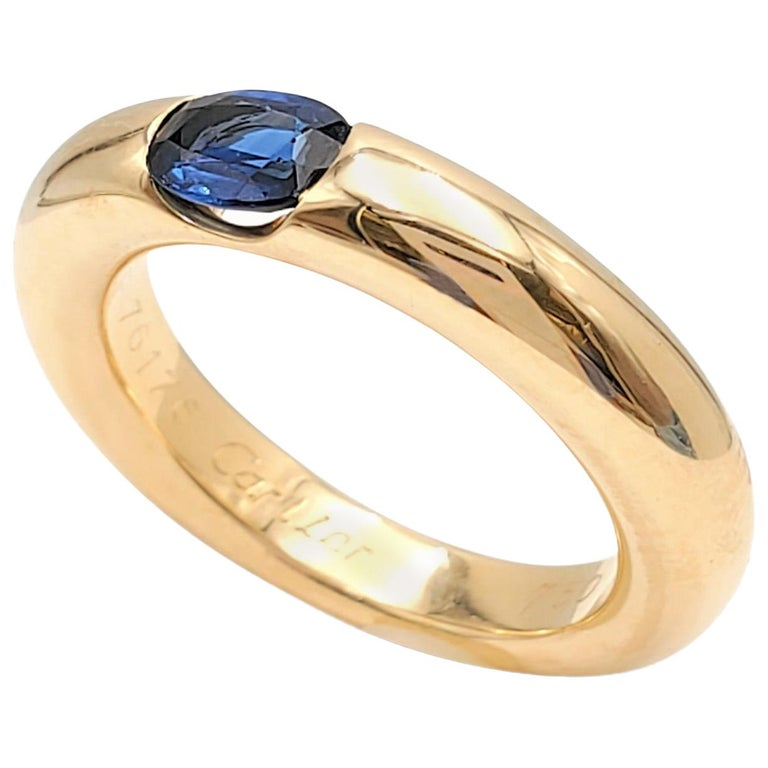 Cartier 'Ellipse' Gold and Sapphire Ring For Sale