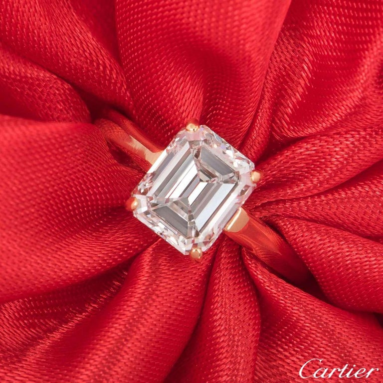 An 18k yellow gold Cartier diamond engagement ring from the 1895 solitaire collection. The ring comprises of an emerald cut diamond in a four claw setting with a weight of 1.84ct , E colour and VS1 in clarity. The ring is currently a size UK G½/US