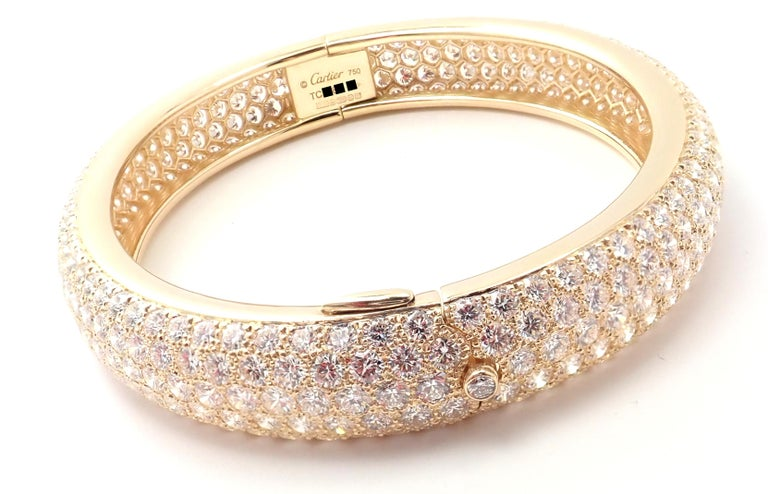 18k Yellow Gold Diamond Pave Etincelle Bangle Bracelet by Cartier.  With 371 round brilliant cut diamonds VVS1 clarity, E color total weight approximately 20ct Details:  Weight: 47 grams Length: 7