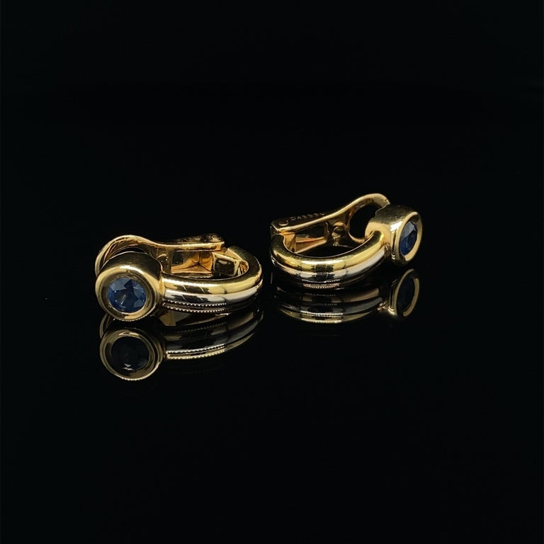 Cartier 'Fogorra' vintage Trinity sapphire 18 karat yellow and white gold earrings  A beautiful pair of vintage Cartier earrings from the mid 1990's 'Forgorra' collection, crafted in three tone 18 karat yellow, white and rose gold, the rounded clips