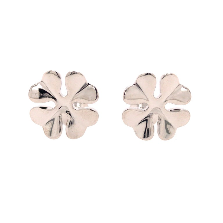 Cartier Four Leaf Clover Cuff Links in Sterling Silver.  The Cuff Links measure 3/4 inch in length and 5/8 inch in width at the top. 14.1 grams. Inscribed