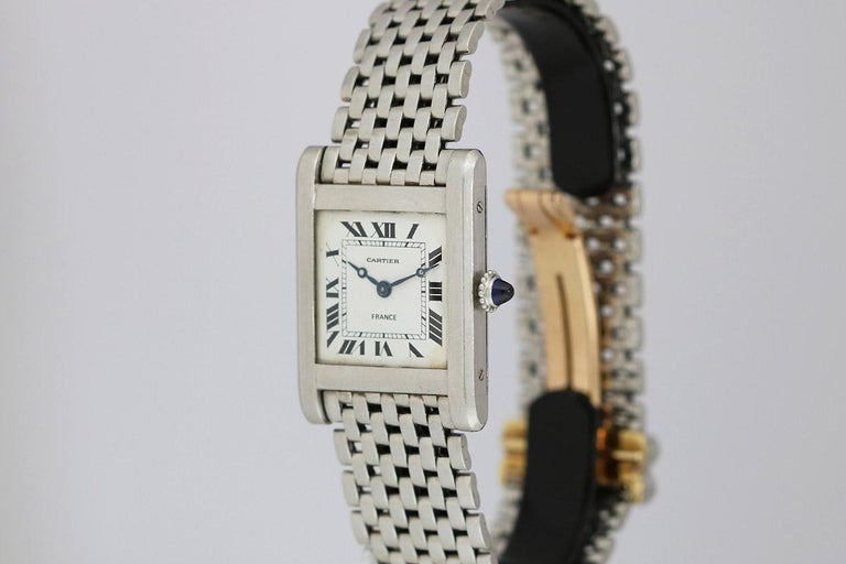 This is a super rare Cartier France Tank Normale in platinum from the 1940s. The condition of this watch is excellent considering its age. The original cream dial has black roman numbers and its original blue steel hands. This special watch comes on