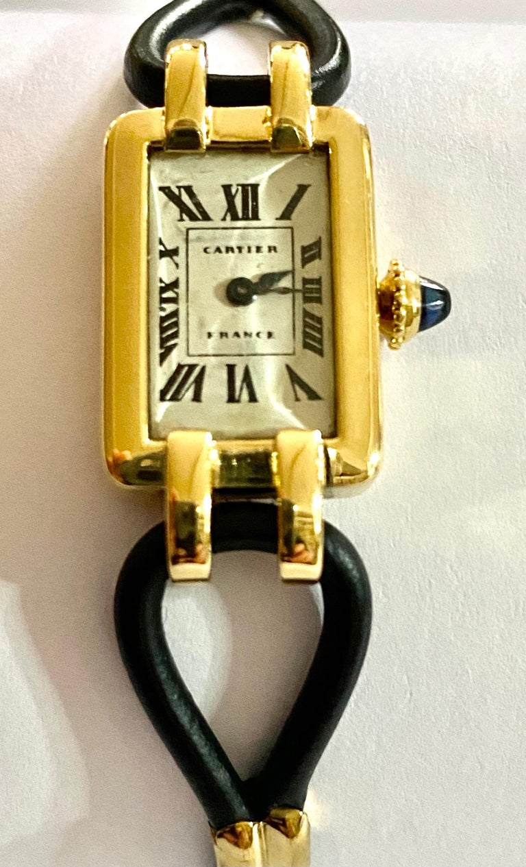 One (1) 18K. yellow gold ladies wristwatch with a leather cordon strap. Signed: Cartier France Period: around 1930 Movement: 19 stone; anchor movement, hand wound. made by: European Watch & Clock Co. {Jaegre le Coultre collaboration} Watch size: 28
