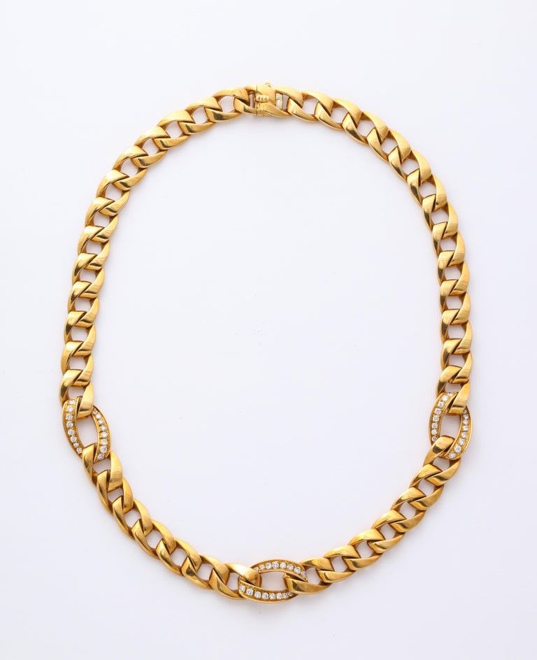 Stunning and classic, always correct, dressed to the gils or wearing a white shirt with denim, this 18 Kt gold Cartier diamond accented necklace makes you conscious of standing tall and elegant. The lovely links are curved like arcs and flattened to
