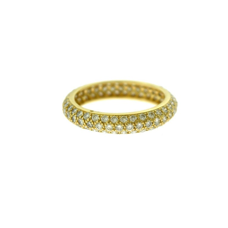 Designer: Cartier  Style: Eternity Band Ring  Metal: Yellow Gold  Metal Purity: 18k  Stones: Round Brilliant Cut Diamonds  Approximate Carat Weight: ~ 3.2 ct  Total Item Weight (grams): 3.0  Ring Size: 51 (euro)   Includes:  24 Months Brilliance