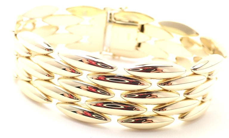 18k Yellow Gold Gentiane 5 Row Rice Link Bracelet by Cartier.  Details:  Length: 7.25