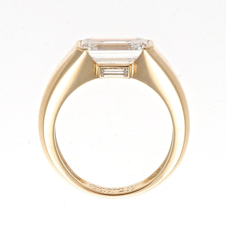 Modern Cartier GIA 2.47 Carat Emerald Cut Diamond Gold Ring For Sale