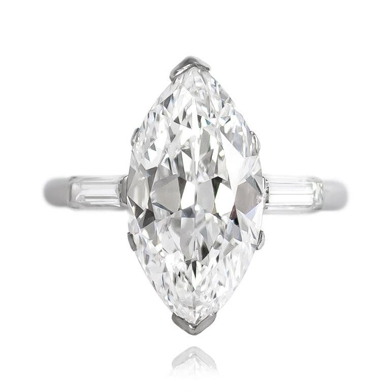 This breathtaking, antique ring from Cartier features a GIA certified, Type IIA 4.06 ct Marquise diamond of D color and VS1 clarity. Set in a handmade, platinum mounting with baguettes = 0.50 ctw (approximately), this ring is a treasure coveted by