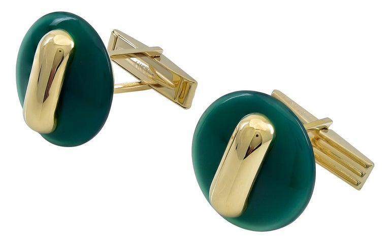 Striking geometric cufflinks.  Made and signed by CARTIER.  18K yellow gold set with lush apple green jade and a gold accent bar.  2/3