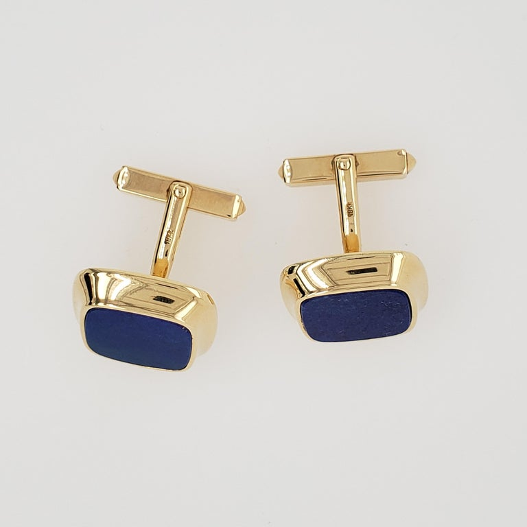 Vintage 18kt Yellow Gold Cartier Hallmarked Lapis Lazuli Cufflinks. The cufflinks are cushion cut in style. The cufflinks were made in Germany. Circa 1980's.