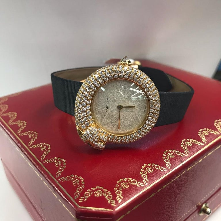 SIGNED CARTIER, PANTHERE 1925 MODEL, REF. 2309, CASE NO. DM10536, CIRCA 2005 Quartz movement, cream engine-turned dial, circular case, emerald-eyed panther-form bezel and band with pave-set diamonds, back secured by four screws, diamond-set crown,