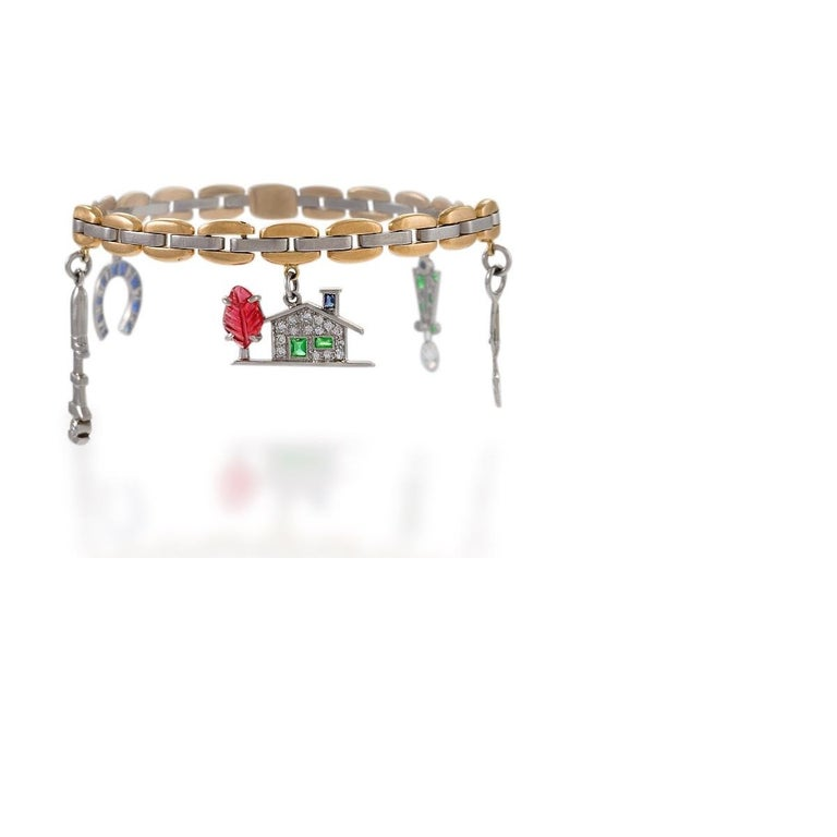 Cartier Gold, Platinum, Diamond, Sapphire, Ruby and Emerald Charm Bracelet In Excellent Condition For Sale In New York, NY