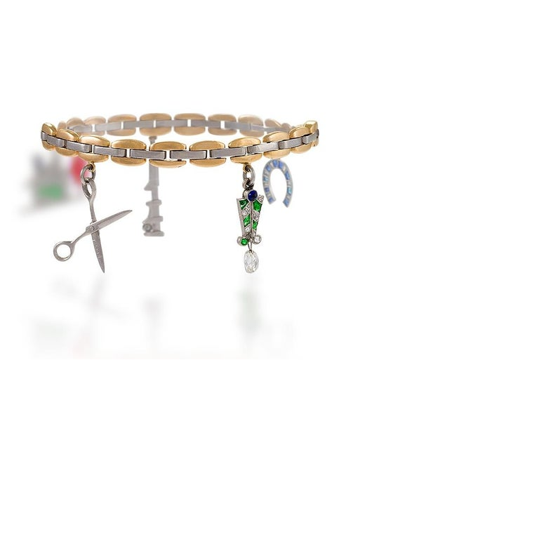 Women's Cartier Gold, Platinum, Diamond, Sapphire, Ruby and Emerald Charm Bracelet For Sale