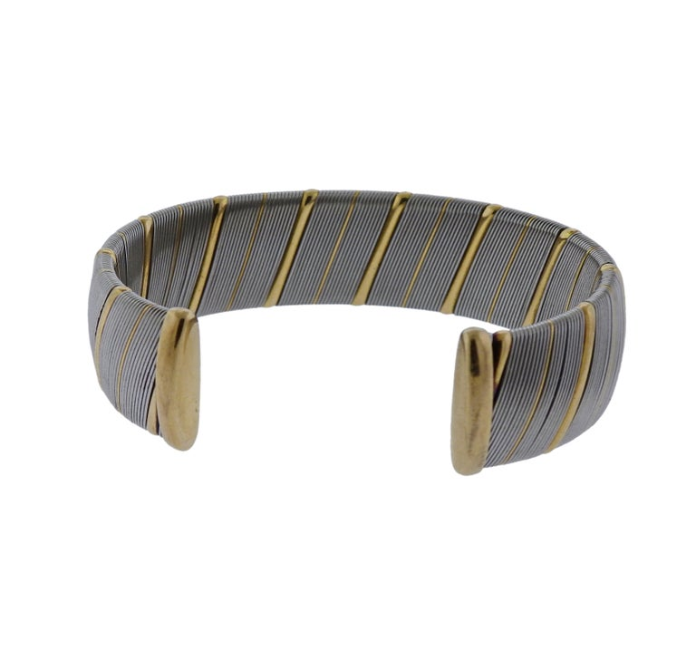 Stainless steel and 18k yellow gold bracelet crafted by Cartier. Bracelet will fit approx. 7.5