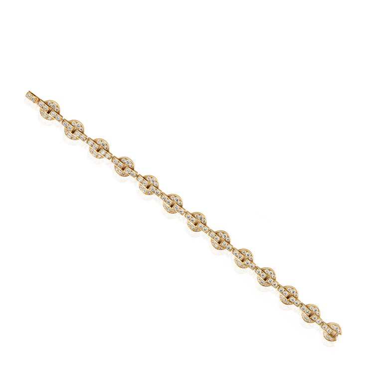 Instantly recognizable as Cartier, this Himalia bracelet features an effortlessly modern circular design throughout. Individual 18k yellow gold circlets are set with the finest Cartier round brilliant cut diamonds, linked together to form this