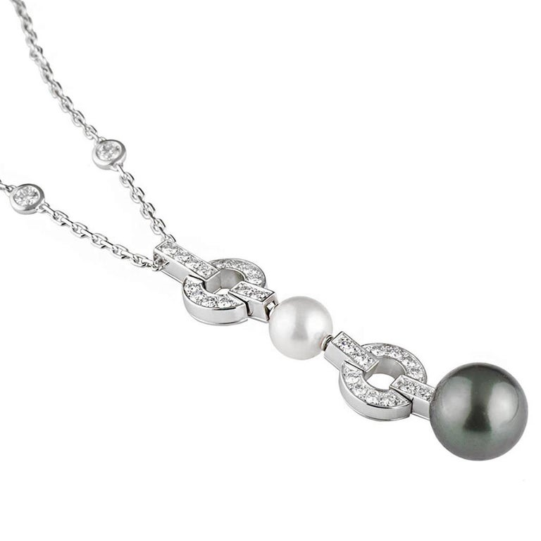 An iconic Cartier pearl diamond drop necklace from the Himalia collection. The necklace is adorned with 32 of the finest cartier round brilliant cut diamonds measuring appx 1.12ct and 2 pearls. The necklace measures 16