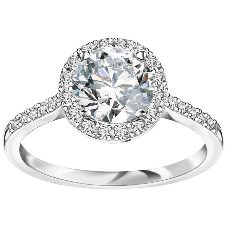 Cartier Inspired Platinum and Diamond Halo Engagement Ring For Sale