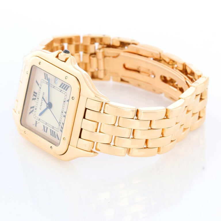 Cartier Jumbo Panther 18k Yellow Gold Men's Quartz Watch with Date W25014B9 - Quartz. 18k yellow gold case (27mm x 37mm). Ivory colored dial with black Roman numerals and date at 3 o'clock. 18k yellow gold Cartier Panther bracelet with deployant