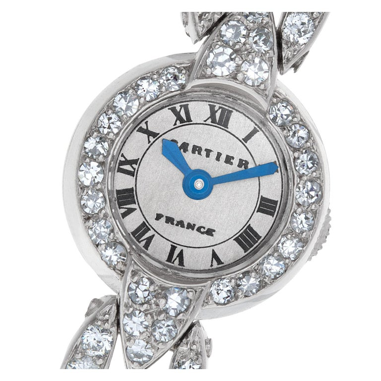 ESTIMATED RETAIL $85000.00 YOUR PRICE $48900.00 Very fine, rare & elegant Cartier European Watch & Clock Co. Art Deco cocktail watch in platinum set with approximately 4.50 carats in bright diamonds. 16 jewels. Manual back wind & set. With original