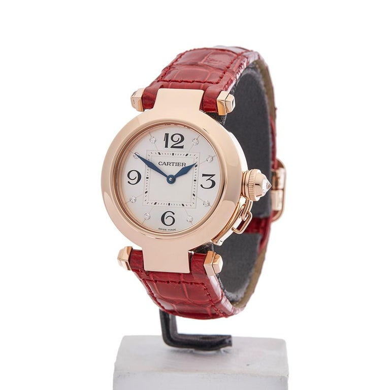Ref: W4127 Model Number: 2812 Serial Number: 122***** Condition: 9 - Excellent Condition Age: 2010's Case Diameter: 32 mm Case Size: 32mm Box And Papers: Box Only Movement: Quartz Case: 18k Rose Gold Dial: Silver Diamonds Bracelet: Red Leather Strap