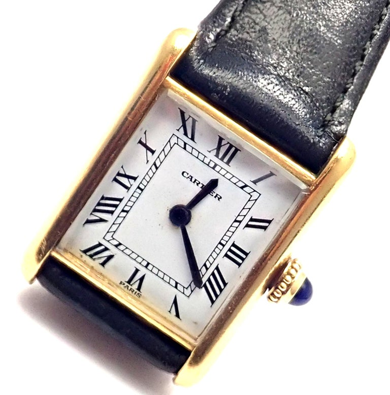 Lady's 18k yellow gold Cartier Mini Tank wristwatch. Details:  Brand: Cartier Case Material: 18k Yellow Gold Dial Color: White Movement: Manual Wind Functions: Hours, Minutes Crystal: Cartier mineral glass crystal Case: 26mm x 19mm Crown:
