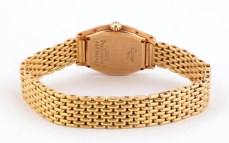 Contemporary Cartier Ladies 18 Karat Gold Diamond Set Manual Wind Tonneau Form Bracelet Watch For Sale