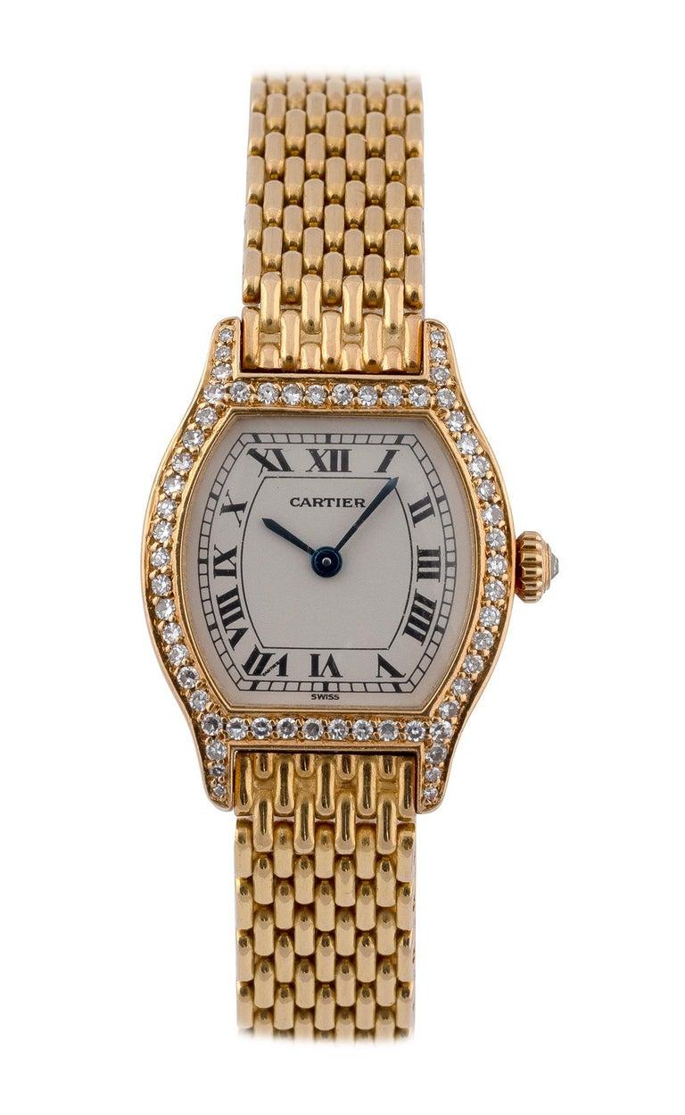 Cartier Ladies 18 Karat Gold Diamond Set Manual Wind Tonneau Form Bracelet Watch In Excellent Condition For Sale In Firenze, IT