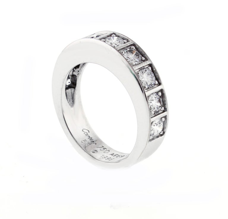 From Cartier's Lanières collection,  a part circle diamond band ring. ♦ Designer: Cartier ♦ Metal: 18 karat white gold ♦ 9 diamonds=1.62 caratE_F VVS ♦ 8mm wide ♦ Circa 1999 ♦ Size  6 ¾ US,  53 French , some adjustment ♦ Packaging: Cartier box ♦