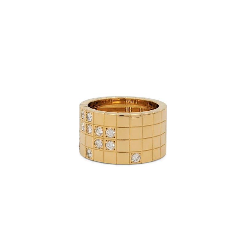 Authentic Cartier 'Lanières' ring crafted in 18 karat yellow gold designed as a continuous sequence of square motifs, accented by a geometric pattern of round brilliant cut diamonds weighing an estimated 0.60 carats total to the front. Signed