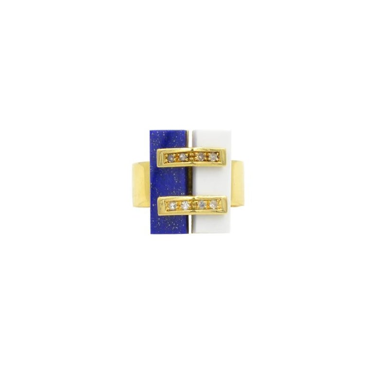 Super stylish Cartier ring with Lapis and White Coral.  Set with 8 single cut round diamonds.  Circa 1970.  Marked