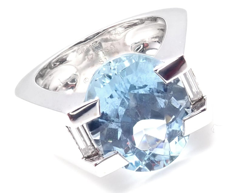 18k White Gold Large Aquamarine Diamonds Ring by Cartier.  With 1 Large Aquamarine 12mm x 10mm 2 Baguette cut diamonds  Details:  Ring Size: European 51, US 5 3/4 Weight: 19.3 grams Width: 12mm Stamped Hallmarks: Cartier 750 51 177169 Cartier