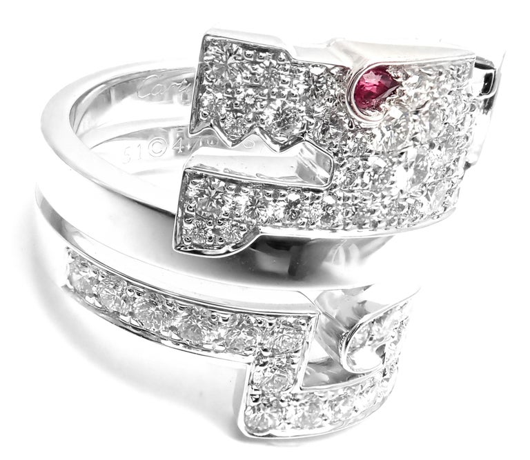 18k White Gold Le Baiser Du Dragon Diamond Ruby Ring by Cartier.  With 56 round brilliant cut diamonds VVS1 clarity, E color total weight  approx. 1.68ct Details:  Ring Size: European 51, US 5 3/4 Width: 19mm Weight: 13.9 grams Stamped Hallmarks: