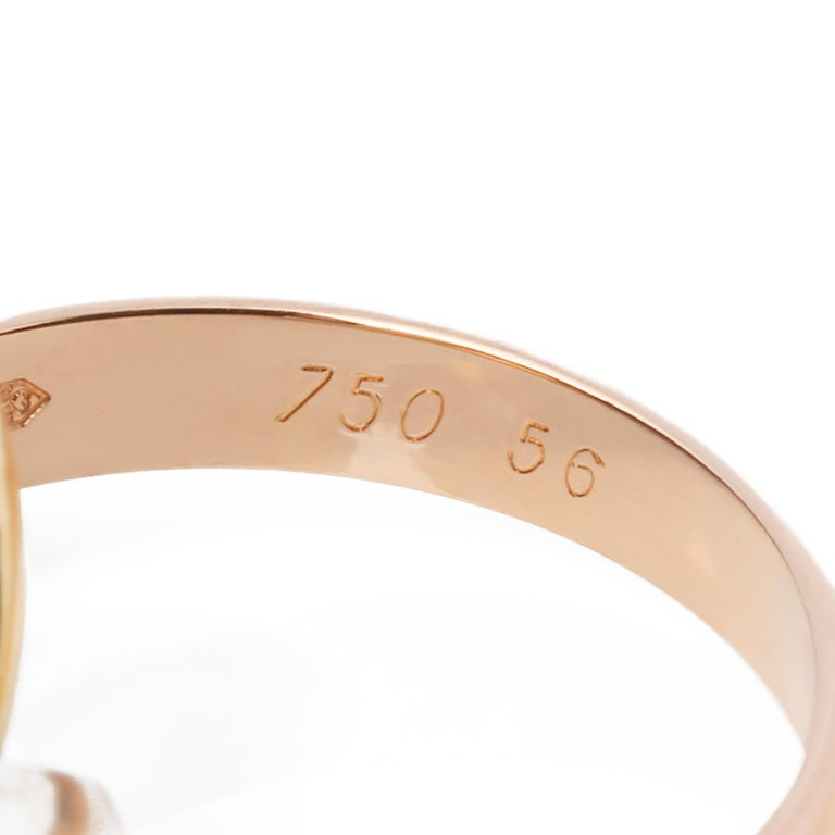 This ring by Cartier is from their Trinity collection and features 18k yellow, white and rose gold interlinking bands. UK ring size P. EU ring size 56. US ring size 7 1/2. This ring cannot be re sized. Complete with a Xupes presentation box. Our