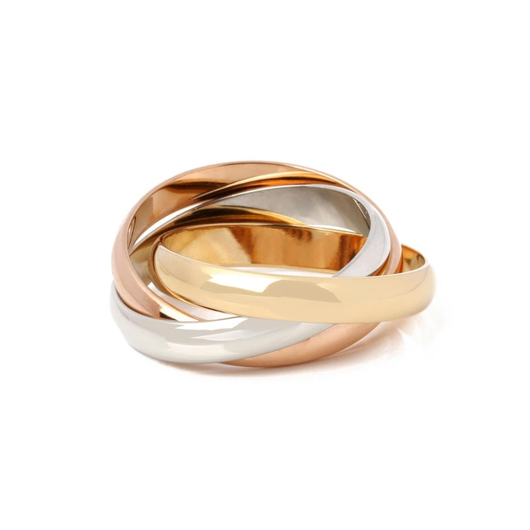 This ring by Cartier is from their Trinity collection and features 18k yellow, white and rose gold interlinking bands. UK ring size L. EU ring size 51. US ring size 6. This ring cannot be resized. Complete with a Xupes presentation box. Our Xupes