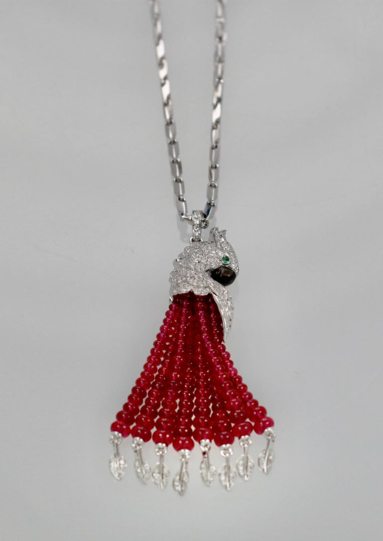 This gorgeous necklace retails for $258,000.  It is new never worn and outstanding.  This necklace has a chain encrusted with Diamonds and the tassels are leaf shaped and covered in Diamonds as well.  The main piece is a diamond head parrot with an