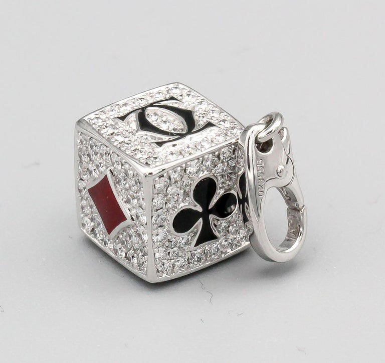 Rare diamond and red and black enamel limited edition (#47 of 70 produced) charm by Cartier. It features high grade round brilliant cut diamonds throughout every side of the square, with playing card suites dressed with red or black enamel, along