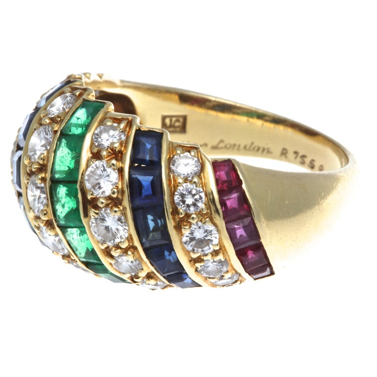 From the London house of Cartier comes a striking find in this ruby, sapphire, emerald, and diamond domed ring. Set in 18k gold are 10 rubies weighing approximately 1.20 carats, 10 sapphires that weigh approximately 2 carats, 5 emeralds that weigh