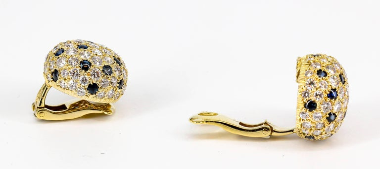 Classic sapphire, diamond and 18k yellow gold dome earrings by Cartier. The earrings are dome shaped and feature approx. 8.0cts of very high grade round brilliant cut diamonds.  Hallmarks: Cartier London, JC, 750,  maker's mark, English standard