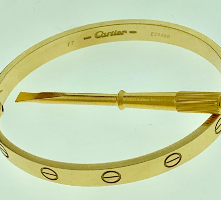 Part of the 'Love' collection. we have spotted this elegant Cartier bracelet on many celebs and models. It features a bangle style crafted from an 18k Yellow gold . The sleek pattern can be stacked with similar style bangles or worn as a stand-alone