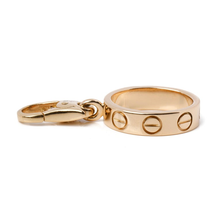 This charm by Cartier is from their Love range and features their iconic screw detailing in 18ct yellow gold. It can be worn as a charm on a bracelet or as a pendant on a chain and is accompanied by a Cartier box and certificate. Our Xupes reference