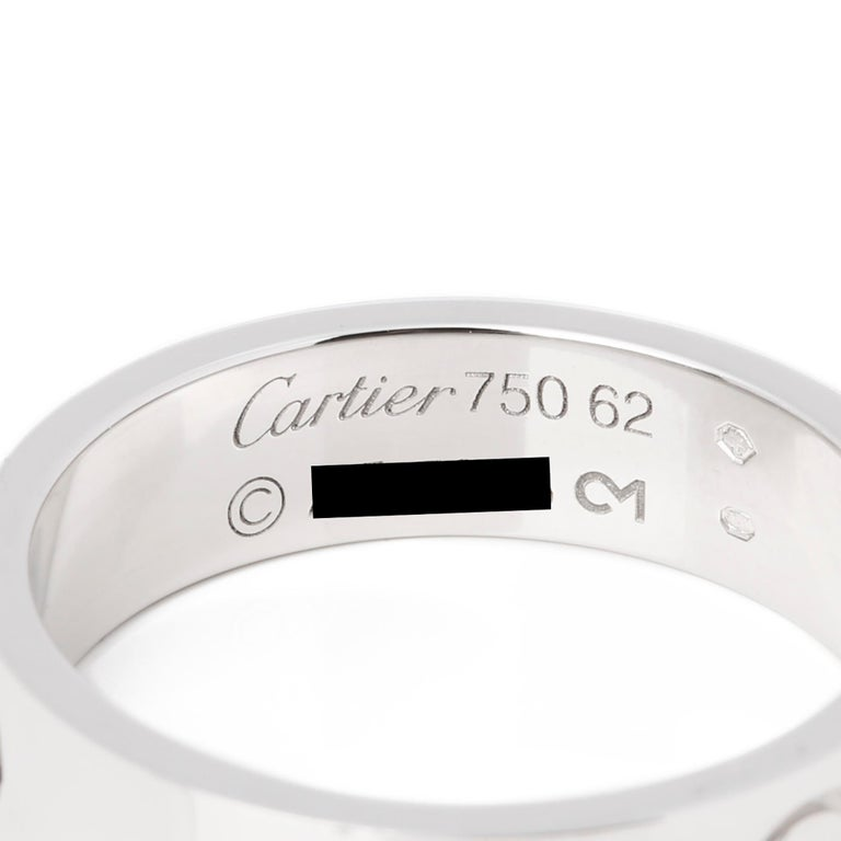 This ring by Cartier is from their Love collection and features their iconic screw detail set in 18ct white gold. UK ring size T 1/2. EU ring size 62. US ring size 10 1/4. Complete with Cartier certificate and Xupes presentation box. Our reference
