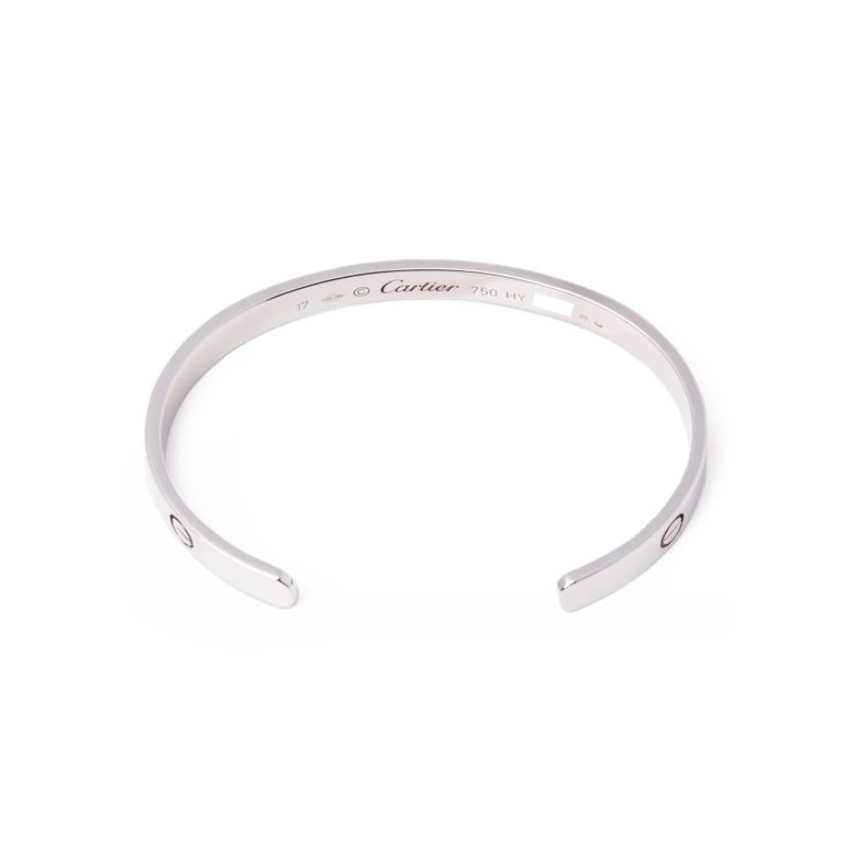 This cuff bangle from Cartier is from their Love collection and features their iconic screw detail set in 18ct white gold. Complete with Xupes presentation box. Our Xupes reference is COMJ490 should you need to quote this.