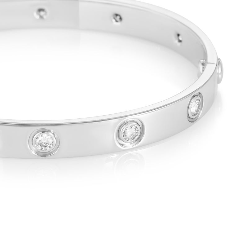 Timelessly elegant and sophisticated in its minimalist design, the iconic Love bracelet from Cartier is an instantly recognizable symbol of romance and commitment, presented in this instance in a splendid blend of 18K white gold and ten glistening