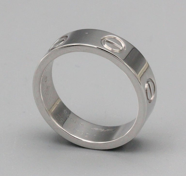 Timeless 18K white gold band from the LOVE collection by Cartier. European size 52.  Current retail price $1770. With box and certificate from Cartier.  Hallmarks: Cartier, 52, reference numbers, 750, copyright, maker's mark.